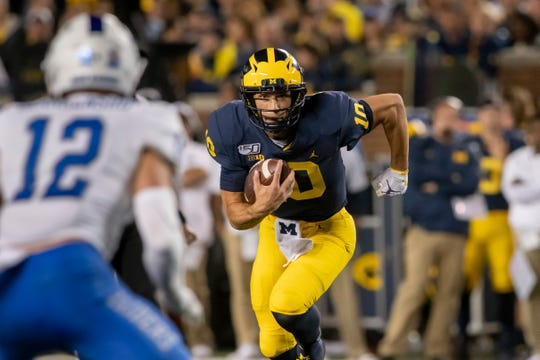 Michigan quarterback Dylan McCaffrey rushed for 42 yards on eight carries in Saturday's win.