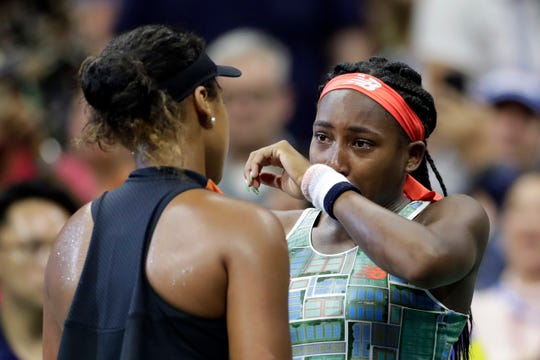 Coco Gauff, right, wipes away tears while talking to Naomi Osaka after Osaka defeated Gauff during the third round of the U.S. Open on Saturday.
