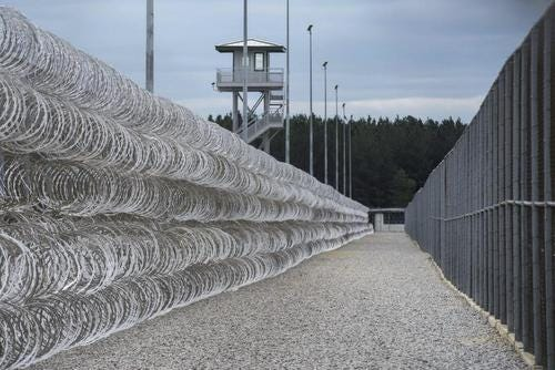Barbed wire and fencing at a correctional facility.