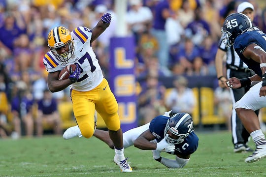 LSU running back Lanard Fournette (27) carries in the first quarter.