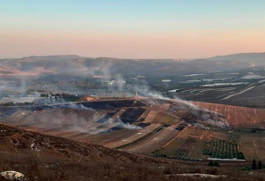 Smoke rises from Israeli army shells that landed in the southern Lebanese border village of Maroun Al-Ras, Lebanon, Sunday.