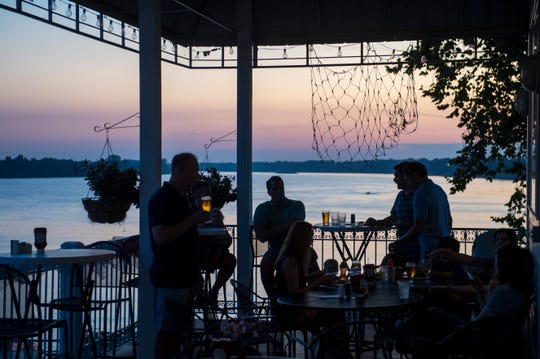 People enjoy the view from Edgewater Grille before the Historic Newburgh Fireworks Saturday evening, Aug. 31, 2019.