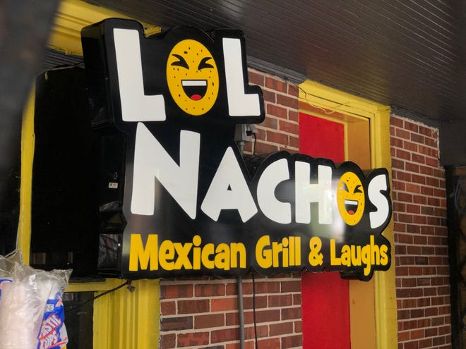 "A new sign reading ""LOL Nachos"" has been added to the outside of Potbelly's in Tallahassee."