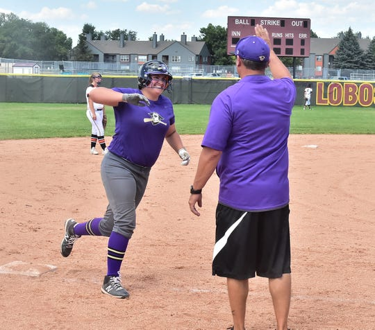 Fort Collins High School softball player Bradie Strang is congratulated by coach Keith Aragon as she rounds third base after hitting a home run in an Aug. 31 win over Grand Junction in a game played at Rocky Mountain High School. Strang and her teammates host cross-town rival Poudre at 4:15 p.m. Tuesday.