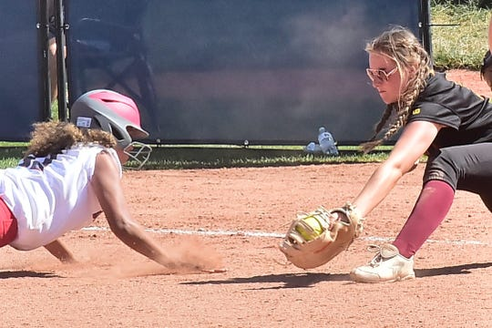 Rocky Mountain High School first baseman Brooklyn Himmelberg reaches to tag out a Smoky Hill base runner during an Aug. 31, 2019, game in a tournament at Triple Crown Sports. Rocky Mountain's scheduled home game Wednesday against cross-town rival Fort Collins has been postponed until 10 a.m. Saturday.