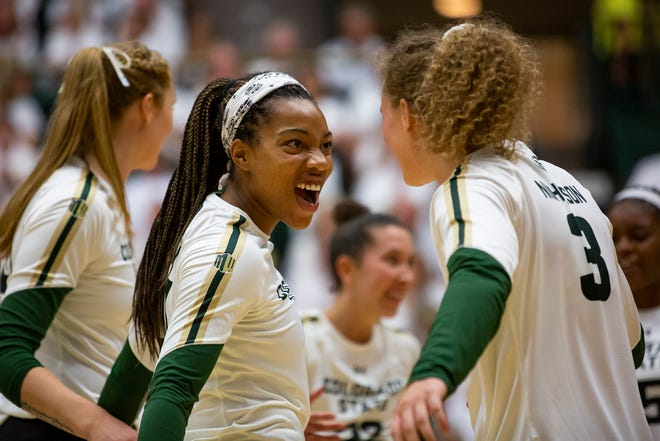 CSU senior hitter Jessica Jackson (21) celebrates after winning a point against Oklahoma on Aug. 31. Jackson recorded 12 kills and led the Rams to a win at Fresno State on Thursday night