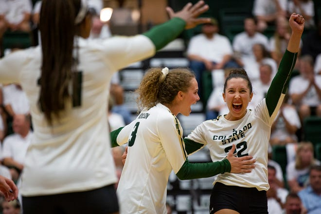 CSU outside hitter Olivia Nicholson (3) and Katie Oleksak (22) celebrate a point in an Aug. 31, 2019, win over Oklahoma. The Rams will play matches against the University of Colorado at 7 p.m. Thursday at Moby Arena in Fort Collins and 6 p.m. Friday at the CU Events Center in Boulder.