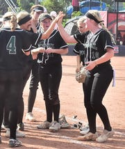 Fossil Ridge High School pitcher Nikki McGaffin (10) receives congratulations from her teammates after striking out 11 batters in a 3-1 win Aug. 31, 2019, over Grand Junction Central in the title game of the Triple Crown Sports' Colorado Women's Sports Fund Association tournament. Fossil Ridge hosts cross-town rival Rocky Mountain at 4:15 p.m. Thursday.