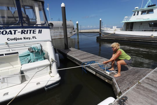 Lancaster, Michigan, resident Patty McKonly ties down her boat at the Pahokee Marina on Sunday, September, 1, 2019 in anticipation of Hurricane Dorian. She and her husband flew down to secure the boat and are flying back out of the way of the powerful storm. They are completing the great loop and Pahokee was their last stop.