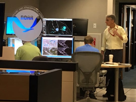 Meteorologist Joel Cline helps out at the National Hurricane Center. He's played a role in forecasting hurricanes for 30 years and assists the official hurricane forecasters in Miami.