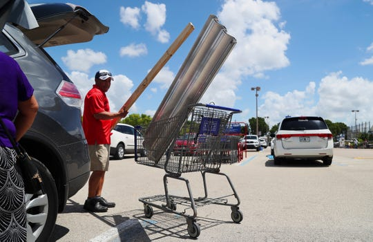 """Just in case,"" Tony Santiago says of preparing for Hurricane Dorian on Sunday at the Lowe's in south Fort Myers. Lowe's is one of several area stores that have restocked supplies to include water, gas containers and generators. A manager at the Lowe's said, if needed, they will ship supplies to stores in areas hardest hit by Hurricane Dorian."