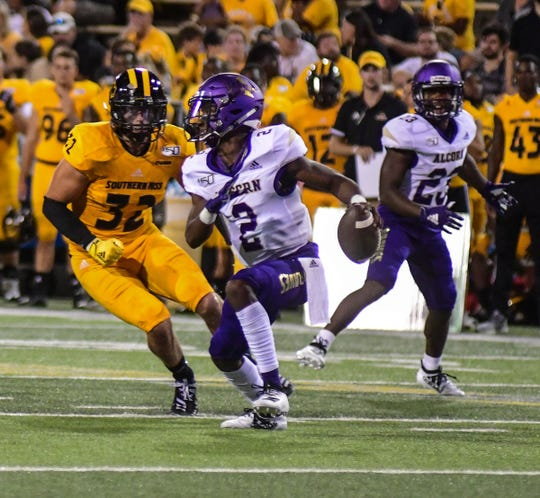 Alcorn Braves quarterback Felix Harper (2) makes a run during the fourth quarter against Southern Miss Aug. 31, 2019.