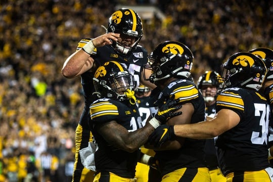 Mekhi Sargent celebrates after his touchdown run gave Iowa a 24-7 lead in the third quarter.