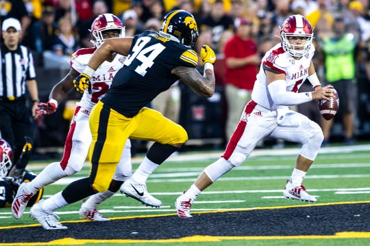 A.J. Epenesa (94) was limited to one tackle in Iowa's 38-14 win, despite playing the most snaps of his career.
