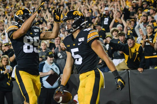 Aug 31, 2019; Iowa City, IA, USA; Iowa Hawkeyes wide receiver Oliver Martin (5) reacts with wide receiver Nico Ragaini (89) after a touchdown pass from quarterback Nate Stanley (not shown) against the Miami (Oh) Redhawks during the third quarter at Kinnick Stadium. Mandatory Credit: Jeffrey Becker-USA TODAY Sports