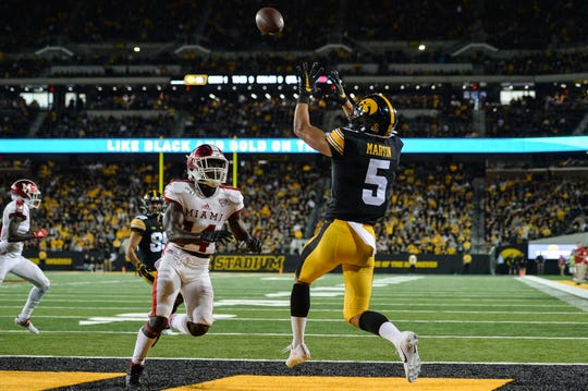 Aug 31, 2019; Iowa City, IA, USA; Iowa Hawkeyes wide receiver Oliver Martin (5) catches a touchdown pass from quarterback Nate Stanley (not shown) over Miami (Oh) Redhawks defensive back Zedrick Raymond (14) during the third quarter at Kinnick Stadium. Mandatory Credit: Jeffrey Becker-USA TODAY Sports