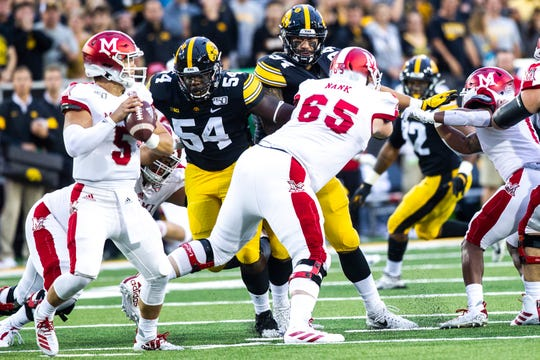 Iowa defensive tackle Daviyon Nixon (54) and defensive end A.J. Epenesa (94) try to get to Miami (Ohio) quarterback Brett Gabbert in an Aug. 31 game. The Hawkeyes have only three sacks through three games, and are working hard to rectify that with Middle Tennessee State up next.