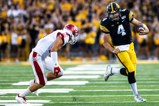 Iowa quarterback Nate Stanley (4) rushes during a NCAA non conference football game, Saturday, Aug. 31, 2019, at Kinnick Stadium in Iowa City, Iowa.