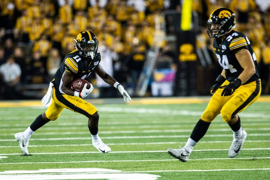 Iowa defensive back Michael Ojemudia (11) intercepts a pass during a NCAA non conference football game, Saturday, Aug. 31, 2019, at Kinnick Stadium in Iowa City, Iowa.