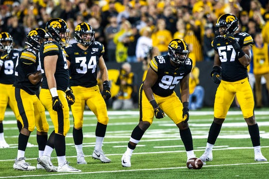 Iowa Hawkeyes defensive lineman Cedrick Lattimore (95) Chauncey Golston (57) Brady Reiff (91) and Iowa linebacker Kristian Welch (34) get ready for a play during a NCAA non conference football game, Saturday, Aug. 31, 2019, at Kinnick Stadium in Iowa City, Iowa.