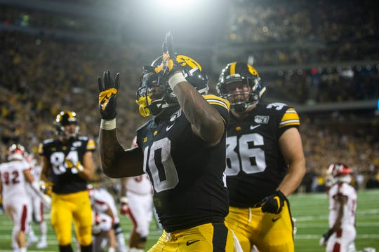 Iowa running back Mekhi Sargent (10) celebrates after scoring a touchdown during a NCAA non conference football game, Saturday, Aug. 31, 2019, at Kinnick Stadium in Iowa City, Iowa.