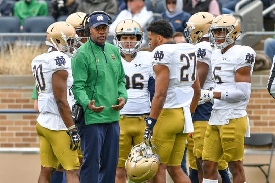 Fighting Irish defensive backs coach Todd Lyght (in green) is the highest-drafted defensive back in the school's storied history.