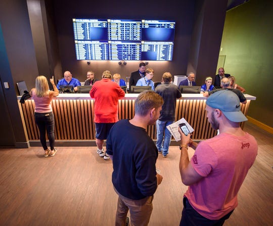Bettors wait at Indiana Grand Racing & Casino Sunday, Sept. 1, 2019, to be among the first in the state to legally bet on sports.