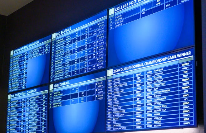 Monitors display the latest lines and bets at Indiana Grand Racing & Casino on Sunday, Sept. 1, 2019. It was the sportsbook's first day of operation.