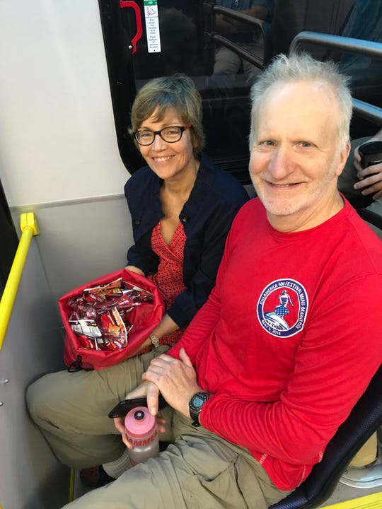 Lauren Otten and Paul Overhauser are some of the first riders of the Red Line, who passed out treats to passengers on opening day, Sept. 1, 2019.