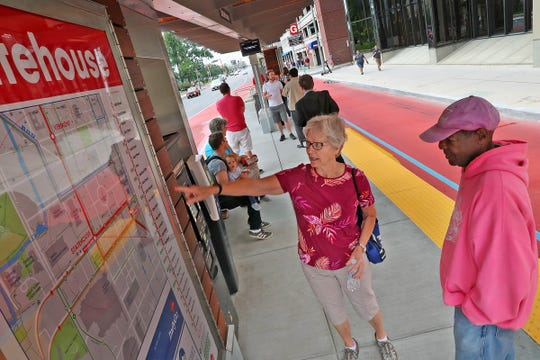 Riders check out a map at the Red Line's Statehouse stop on Capitol Avenue, on opening day, Sunday, Sept. 1, 2019.