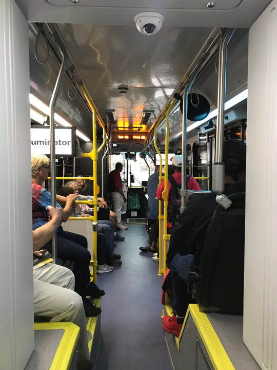 Passengers on one of the first Red Line buses in service on Sept. 1, 2019.