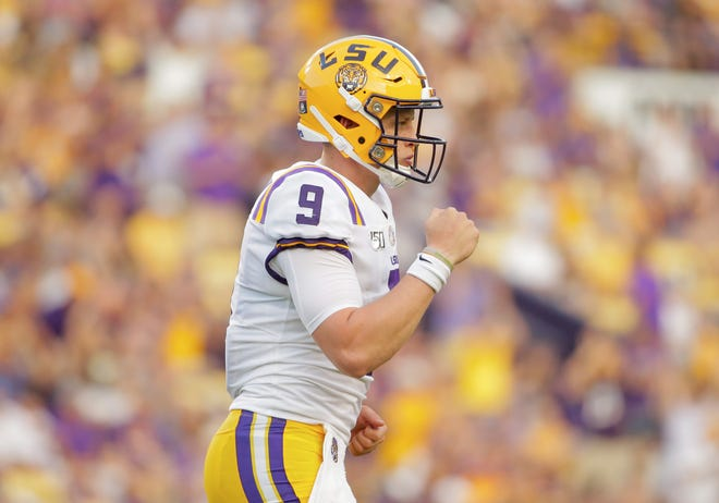 Aug 31, 2019; Baton Rouge, LA, USA; LSU Tigers quarterback Joe Burrow (9) celebrates after a touchdown pass against the Georgia Southern Eagles during the first quarter at Tiger Stadium. Mandatory Credit: Derick E. Hingle-USA TODAY Sports