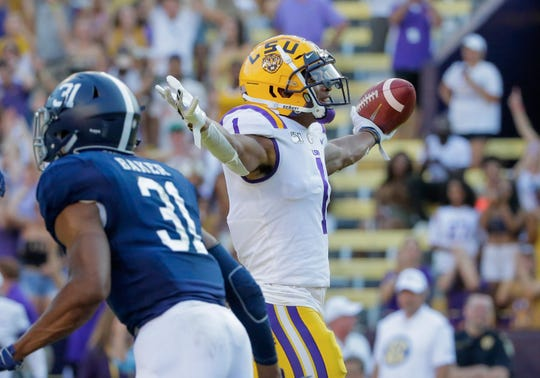 Aug 31, 2019; Baton Rouge, LA, USA; LSU Tigers wide receiver Ja'Marr Chase (1) celebrates after a touchdown against the Georgia Southern Eagles during the first quarter at Tiger Stadium. Mandatory Credit: Derick E. Hingle-USA TODAY Sports