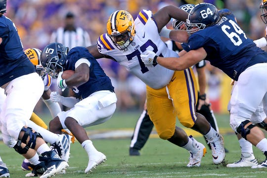 LSU nose tackle Tyler Shelvin (72) tackles Georgia Southern running back Matt LaRoche (5) at the line of scrimmage in the first quarter of an NCAA college football game in Baton Rouge, La., Saturday, Aug. 31, 2019. (AP Photo/Michael Democker)