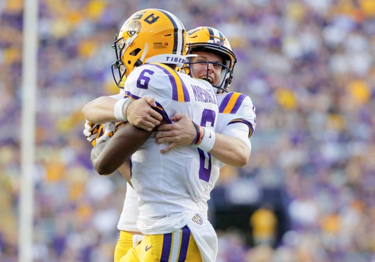 LSU quarterback Joe Burrow (9) celebrates with wide receiver Terrace Marshall Jr. after a touchdown against Georgia Southern.