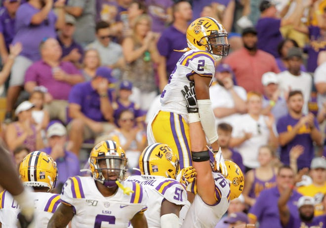 Aug 31, 2019; Baton Rouge, LA, USA; LSU Tigers wide receiver Justin Jefferson (2) celebrates with offensive lineman Austin Deculus (76) after a touchdown against the Georgia Southern Eagles during the first quarter at Tiger Stadium. Mandatory Credit: Derick E. Hingle-USA TODAY Sports