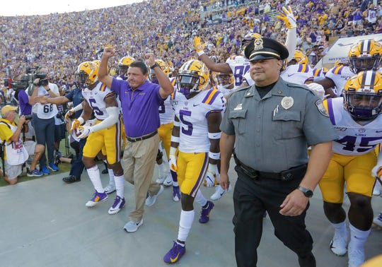 Aug 31, 2019; Baton Rouge, LA, USA; LSU Tigers head coach Ed Orgeron leads his team onto the field prior to kickoff against the Georgia Southern Eagles at Tiger Stadium. Mandatory Credit: Derick E. Hingle-USA TODAY Sports