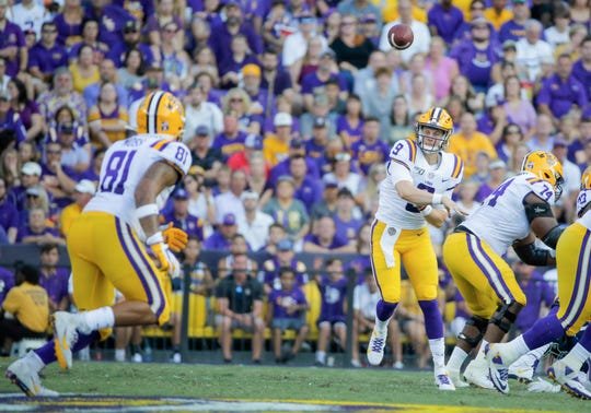 Aug 31, 2019; Baton Rouge, LA, USA; LSU Tigers quarterback Joe Burrow (9) throws to tight end Thaddeus Moss (81) during the first quarter against the Georgia Southern Eagles at Tiger Stadium. Mandatory Credit: Derick E. Hingle-USA TODAY Sports