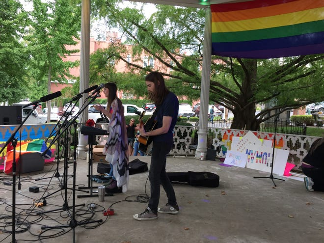 """Jessica Bouffioux, of Lancaster, and Kurt McGuiness, of Hilliard, performed Saturday as """"Shadow in the Moon"""" in downtown Lancaster."""