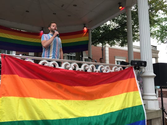 John McClain, of Logan, sings the National Anthem Saturday at the Pride event in downtown Lancaster.