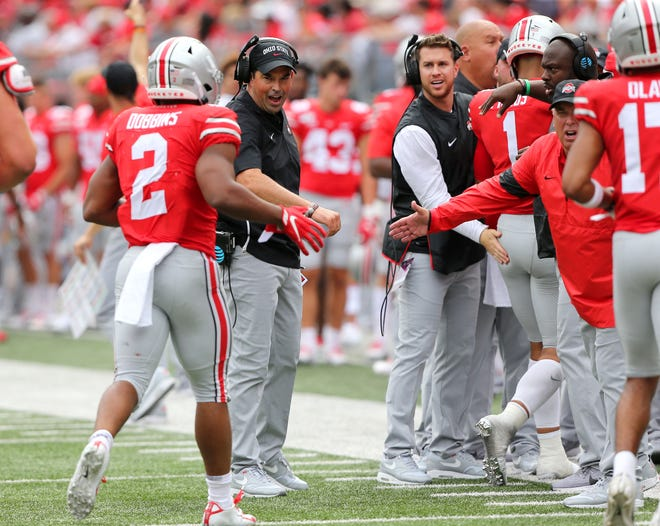 Ohio State coach Ryan Day congratulates tailback J.K. Dobbins after he scores a fourth quarter touchdown in the Buckeyes' 45-21 win over Florida Atlantic in the season opener.