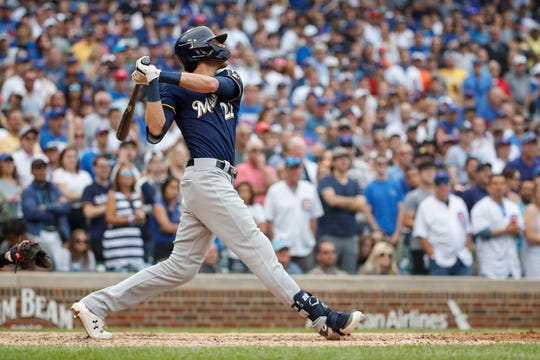 Christian Yelich connects for a three-run home run in the ninth inning Sunday at Wrigley Field.