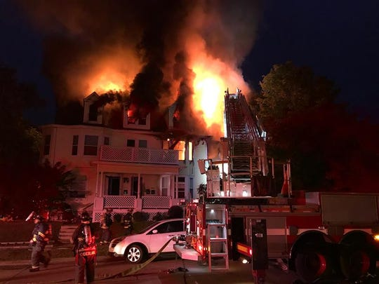 Fire engulfs the third floor of a multi-unit home. Multiple residents were evacuated Saturday evening.