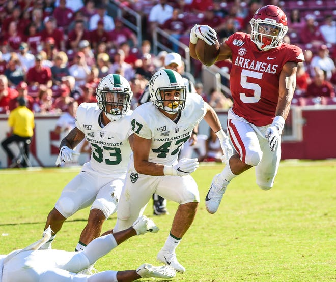 Arkansas running back Rakeem Boyd (5) runs for a first down against Portland State on Saturday in Fayetteville.