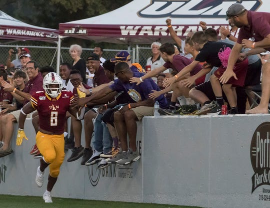 ULM's Josh Johnson (8) high fives fans in the South endzone after getting the first touchdown of game against Grambling State at Malone Stadium in Monroe, La. on Aug. 31.