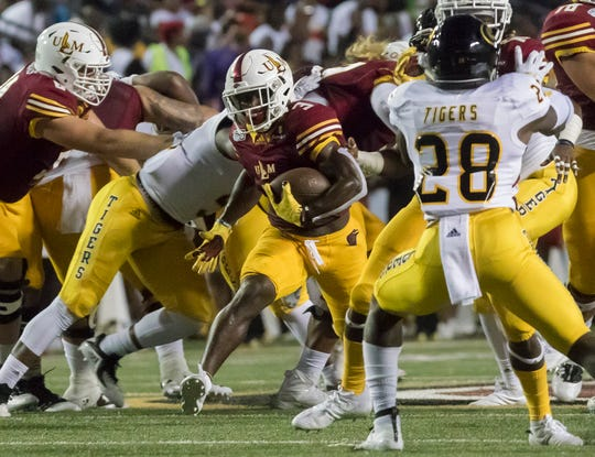 Running back Isaiah Phillips (3) breaks into the open field against Grambling State in ULM's 31-9 season-opening win at Malone Stadium on August 31. The Warhawks spent the week getting a plan together to block Iowa State safety Greg Eisworth.