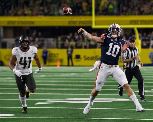 Auburn quarterback Bo Nix (10) throws the ball at AT&T Stadium in Arlington, Texas, on Saturday, Aug. 31, 2019. Auburn defeated Oregon 27-21.