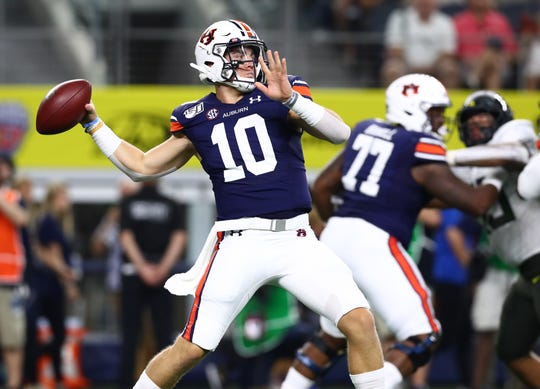 Aug 31, 2019; Arlington, TX, USA; Auburn Tigers quarterback Bo Nix (10) throws in the pocket in the first quarter against the Oregon Ducks at AT&T Stadium. Mandatory Credit: Matthew Emmons-USA TODAY Sports