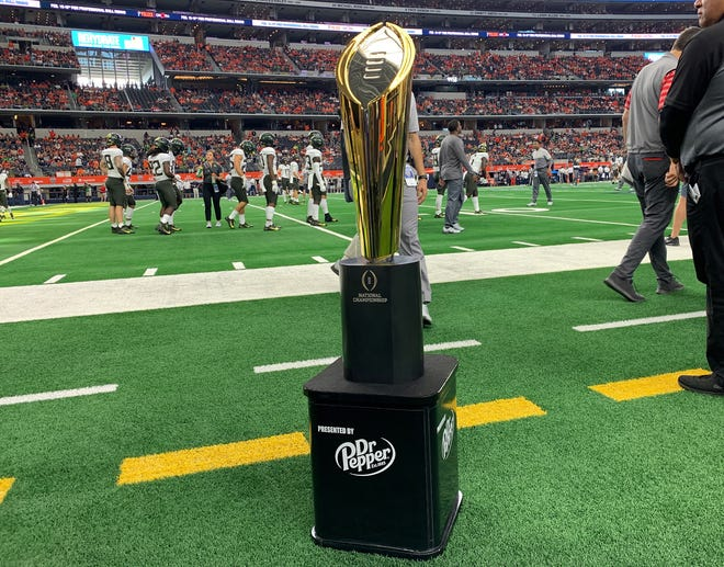 Aug 31, 2019; Arlington, TX, USA; College Football Playoff National Championship Trophy on display prior to the game with the Auburn Tigers playing against the Oregon Ducks at AT&T Stadium. Mandatory Credit: Matthew Emmons-USA TODAY Sports