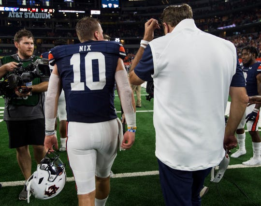 Auburn quarterback Bo Nix (10) and Auburn head coach Gus Malzahn walk off the field at AT&T Stadium in Arlington, Texas, on Saturday, Aug. 31, 2019. Auburn defeated Oregon 27-21.